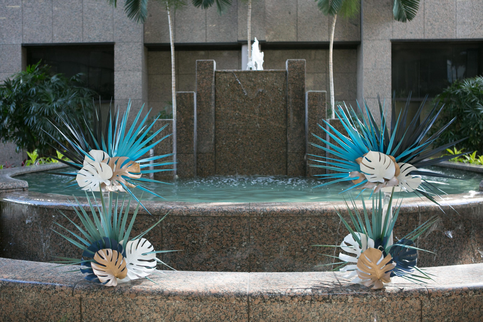 Unique Tropical Wedding Ceremony Decor, Green, Gold and Ivory Palm Tree and Monstera Leaves on Fountain | Wedding Planner John Campbell Weddings and Events | Tampa Wedding Venue Centre Club