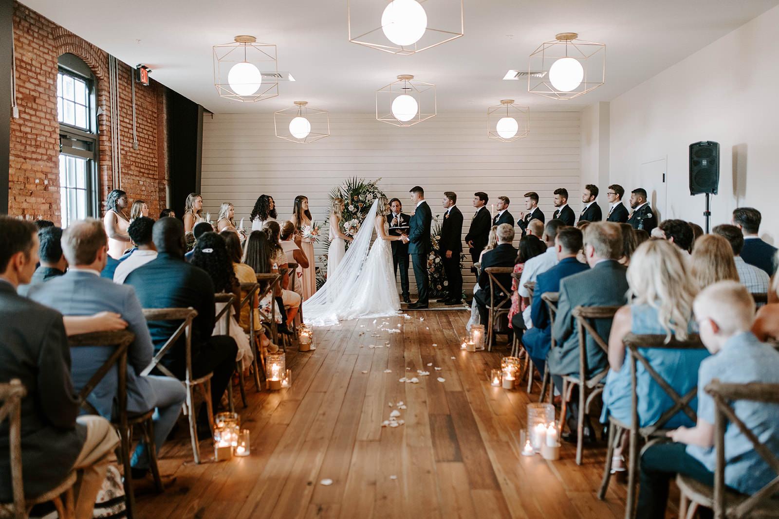 Boho Whimsical Wedding Ceremony Bride and Groom Exchanging Wedding Vows Portrait   Industrial Tampa Bay Wedding Venue Armature Works   Tampa Bay Wedding Planner Coastal Coordinating
