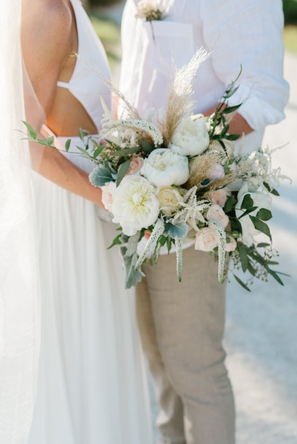 Bride and Groom Wedding Portrait with Bride's Whimsical Wedding Bouquet with Greenery | Resort at Longboat Key Club