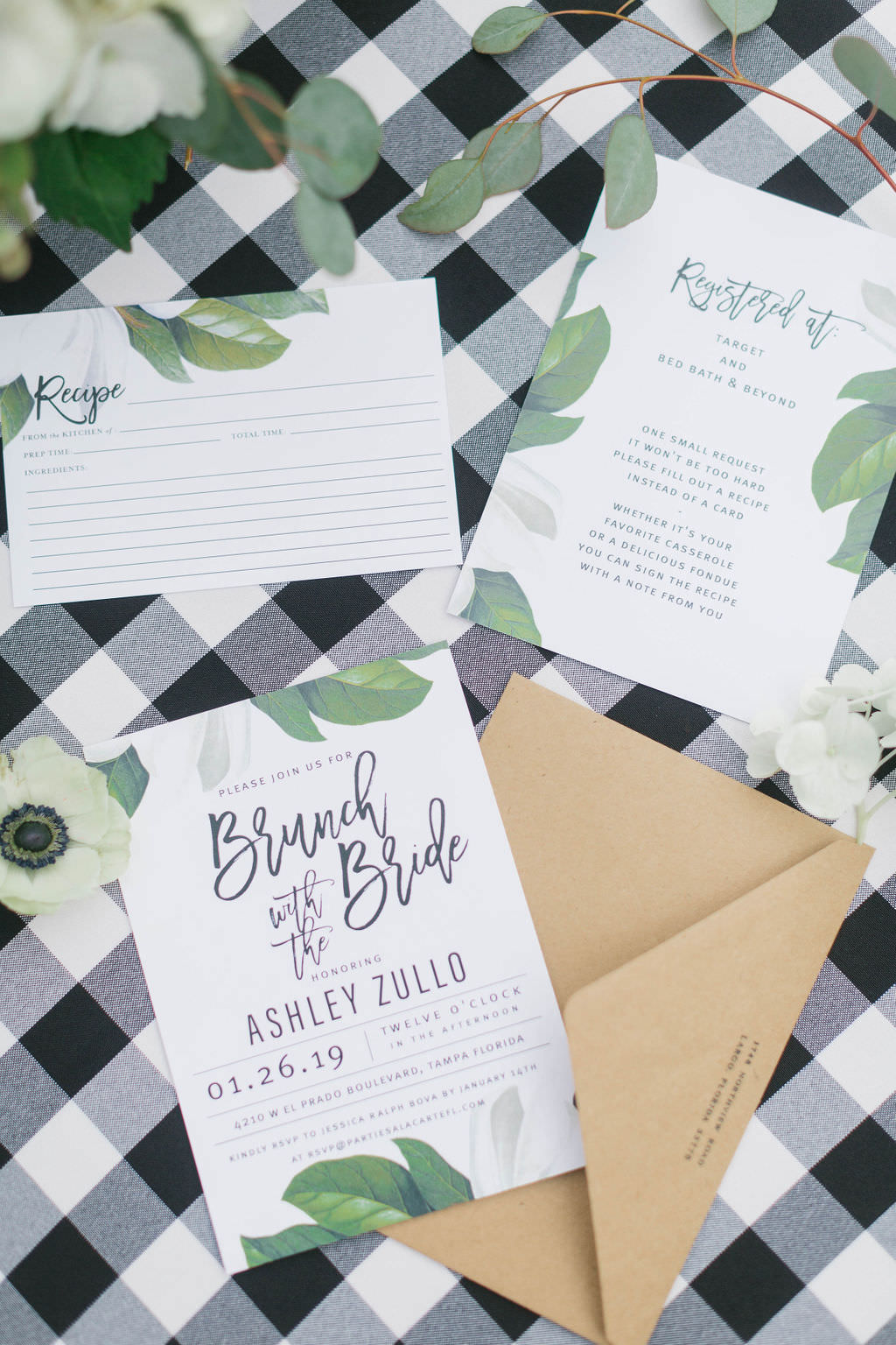 Magnolia Market Inspired Bridal Shower Invitation with Magnolia Flowers on Buffalo Plaid Linen | Over the Top Rental Linens