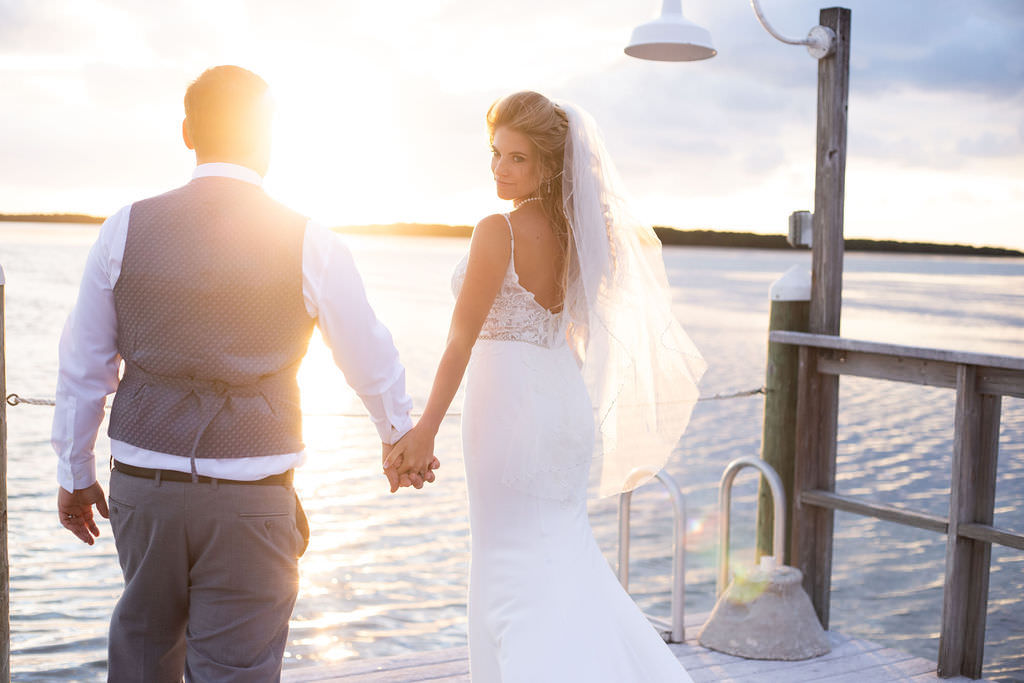 Romantic Sunset Waterfront Pier Tampa Bay Bride and Groom Wedding Portrait, Bride in Fitted Lace Open Back with Spaghetti Straps Maggie Sottero Wedding Dress