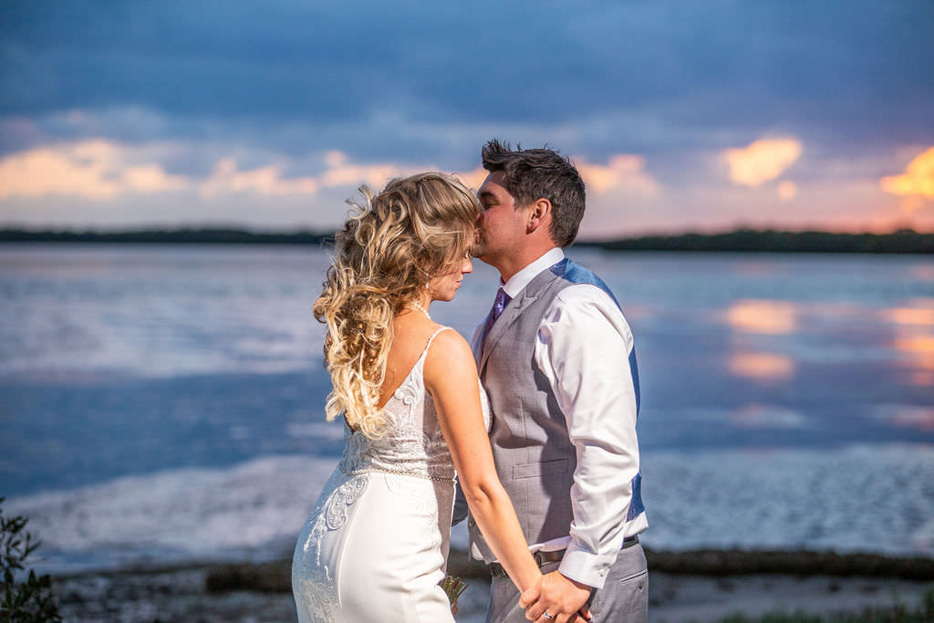 Romantic Sunset Waterfront Tampa Bay Bride and Groom Wedding Portrait, Bride in Fitted Lace Open Back with Spaghetti Straps Maggie Sottero Wedding Dress