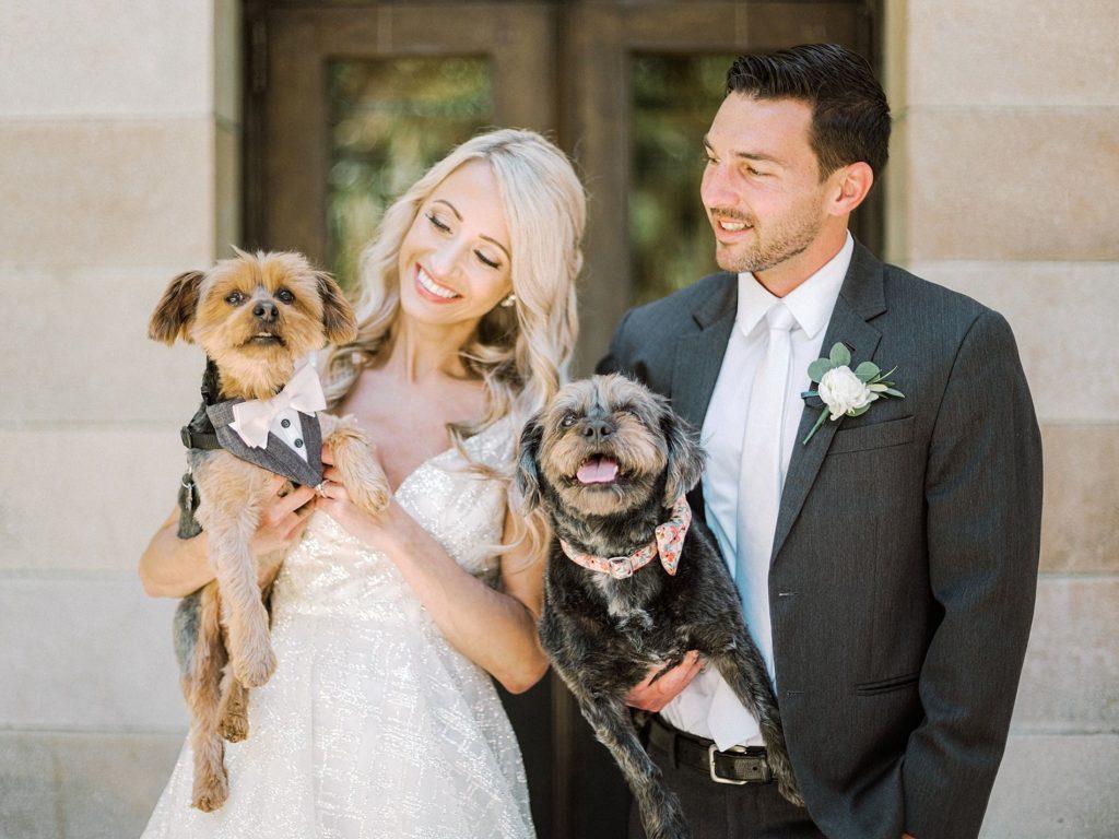 Sarasota Bride and Groom Holding Dogs Wedding Portrait