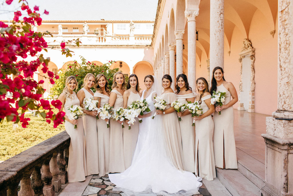 Classic Bride Holding White Orchids and Roses with Greenery Floral Bouquet and Bridesmaids in Neutral Champagne Cream Mix and Match Dresses Bridal Party Portrait at Sarasota Wedding Venue Ca d'Zan at The Ringling Museum   Tampa Bay Wedding Hair and Makeup Femme Akoi Beauty Studio   Sarasota Wedding Planner NK Productions
