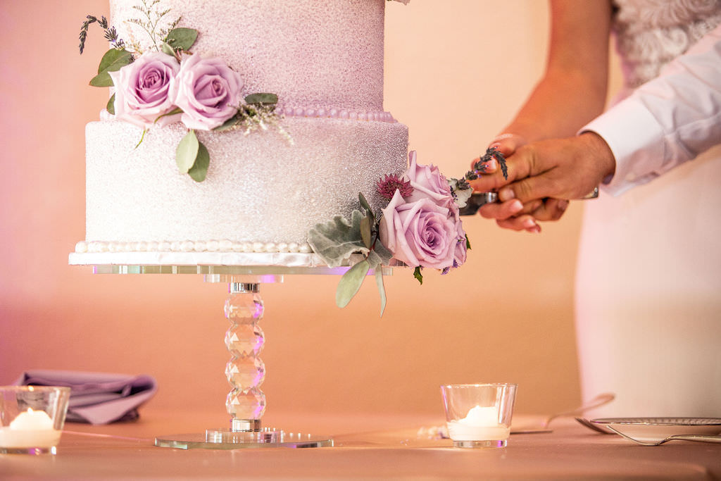 Simple and Elegant Wedding Cake with Glitter Embellishments, Lilac Roses with Eucalyptus on Crystal Cake Stand, Bride and Groom Cake Cutting Portrait | Tampa Bay Wedding Cake Bakery The Artistic Whisk
