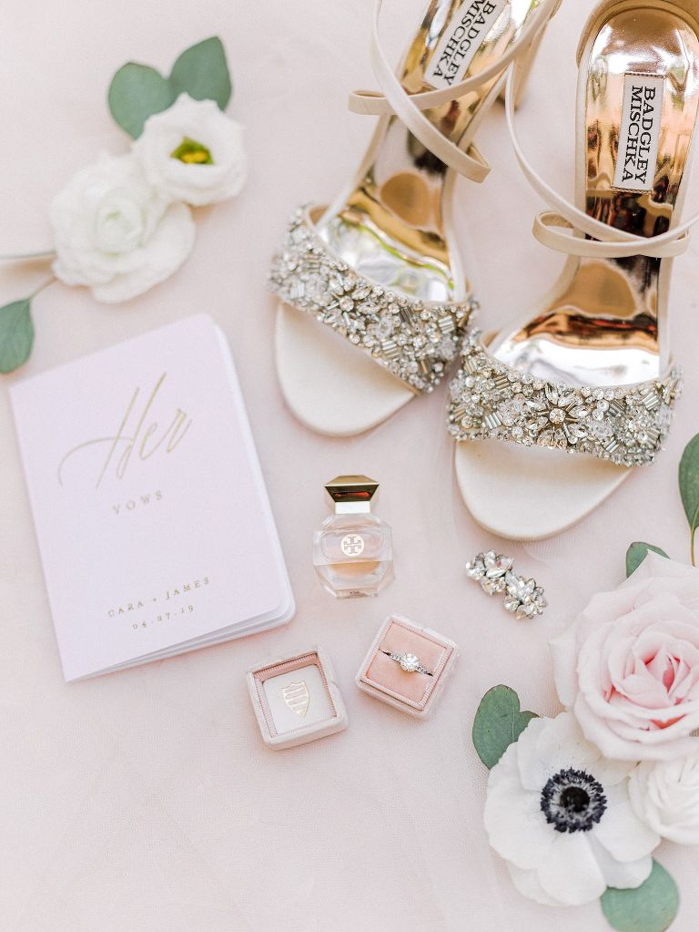 Badgley Mischka Ivory Chunky Rhinestone Strappy Sandal Wedding Shoes, Gold Foil Her Vows Book, Solitaire Round Diamond Engagement Ring in Blush Pink Ring Box