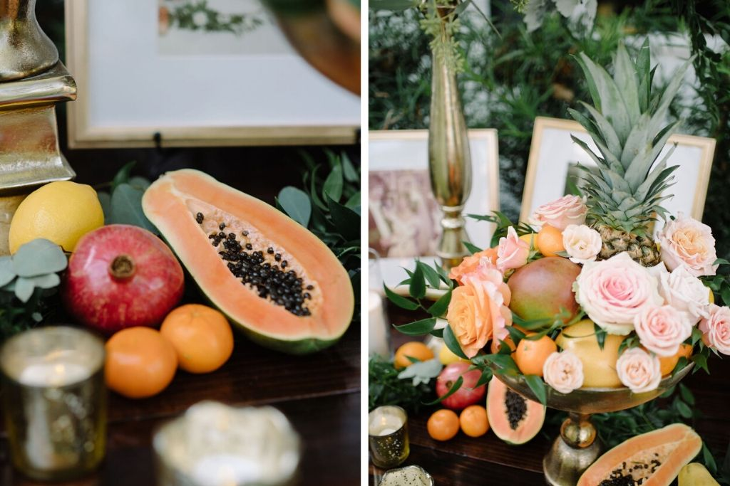 Whimsical Romantic Wedding Reception Decor, Rustic Wooden Table with Pomegranate, Papaya, Oranges and Lemon Fruits, Gold Bowl with Blush Pink and Orange Roses, Pineapple and Fruits Arrangement | Tampa Bay Wedding Florist Bruce Wayne Florals | St. Pete Wedding Rentals Gabro Event Services