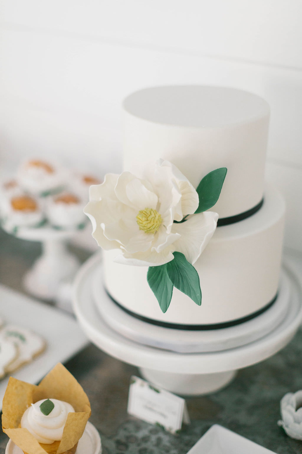 Bridal Brunch Dessert Sweets Bar with Small Two Tiered White Cake with Sugar Flower Magnolia Decor