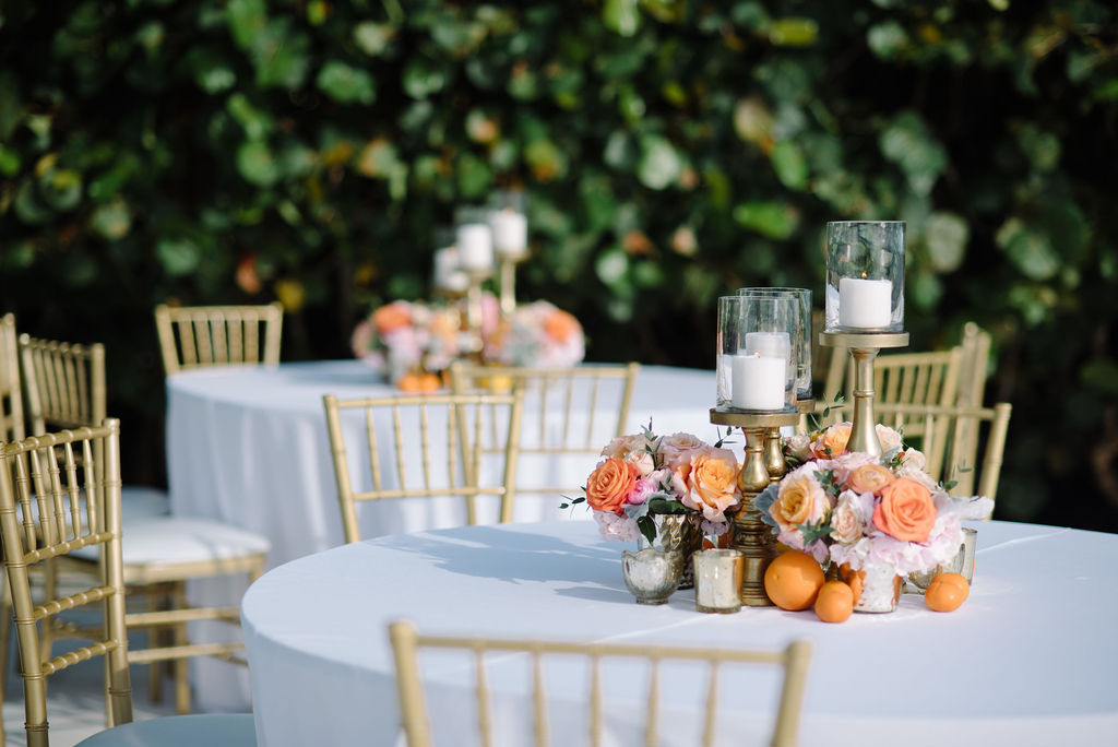 Whimsical Romantic Wedding Reception Decor, Round Tables with White Linens, Gold Chiavari Chairs, Blush Pink Peonies, Orange Roses in Gold Vases Small Centerpieces, Tall Gold Candlesticks and Orange Fruits | Tampa Bay Wedding Florist Bruce Wayne Florals | St. Pete Wedding Rentals Gabro Event Services