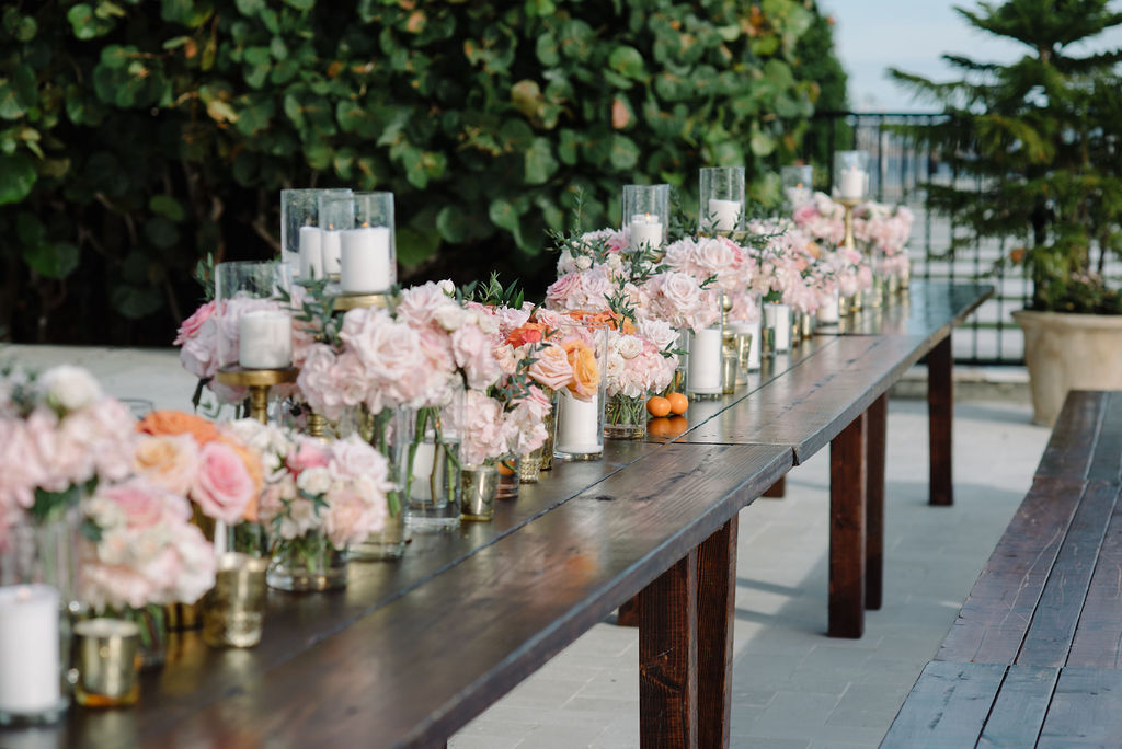 Whimsical Romantic Wedding Reception Decor, Long Rustic Wooden Feasting Table, Blush Pink Roses Floral Arrangements, Gold Candlesticks | St. Pete Wedding Rentals Gabro Event Services | Tampa Wedding Florist Bruce Wayne Florals