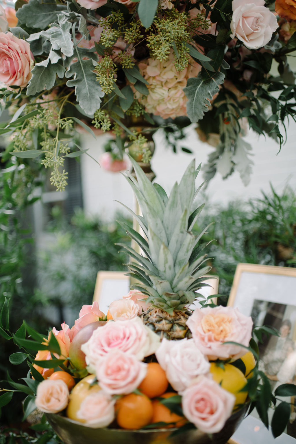 INSTAGRAM Whimsical Wedding Reception Decor, Blush Pink Roses with Oranges, Lemons and Pineapple Fruit in Bowl, Tall Gold Candlestick with Hydrangeas and Greenery Floral Arrangement | Tampa Bay Wedding Florist Bruce Wayne Florals