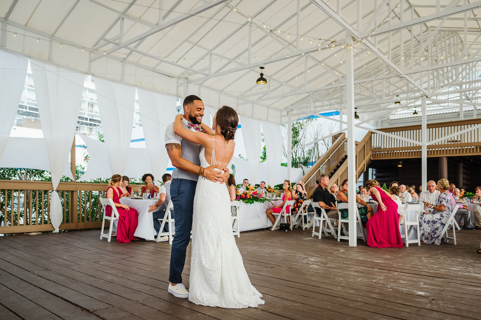 Tropical Florida Bride and Groom First Dance Wedding Reception Portrait | Waterfront Hotel Wedding Venue Hilton Clearwater Beach Resort and Spa | Tampa Bay Wedding DJ and Entertainment Grant Hemond and Associates
