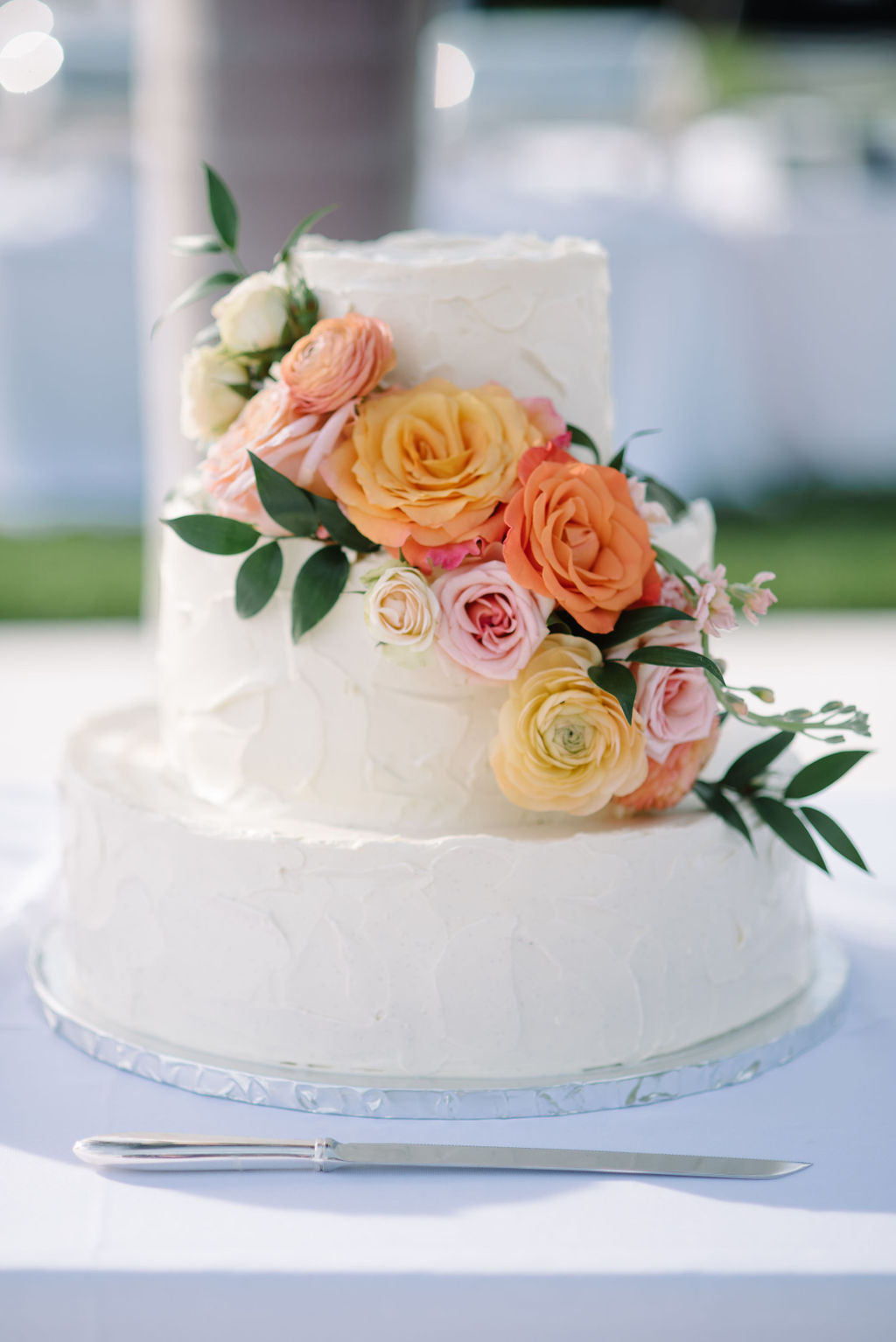 INSTAGRAM Two Tier Classic Textured Buttercream Wedding Cake with Real Blush Pink, Orange and Ivory Roses Cascading | Tampa Bay Wedding Florist Bruce Wayne Florals