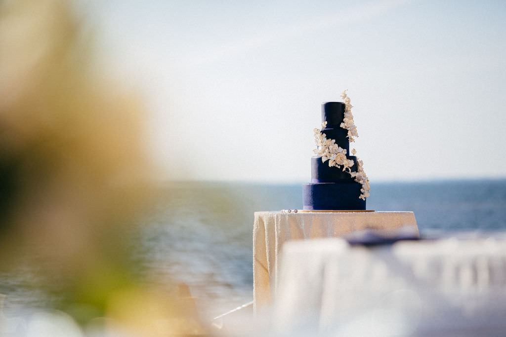 Four Tier Navy Blue Wedding Cake with Cascading White Flowers