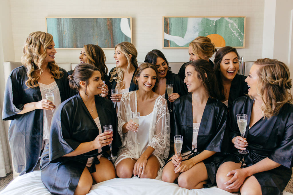 Florida Classic Bride with Bridesmaids in Matching Navy Blue Robes and Champagne Portrait   Tampa Bay Hair and Makeup Femme Akoi Beauty Studio