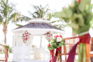 Tropical Wedding Ceremony Decor, White Tulips, Red and Greenery Floral Arrangements | Tampa Bay Wedding Photographer Lifelong Photography Studios | Waterfront St. Pete Wedding Venue Isla Del Sol Yacht and Country Club