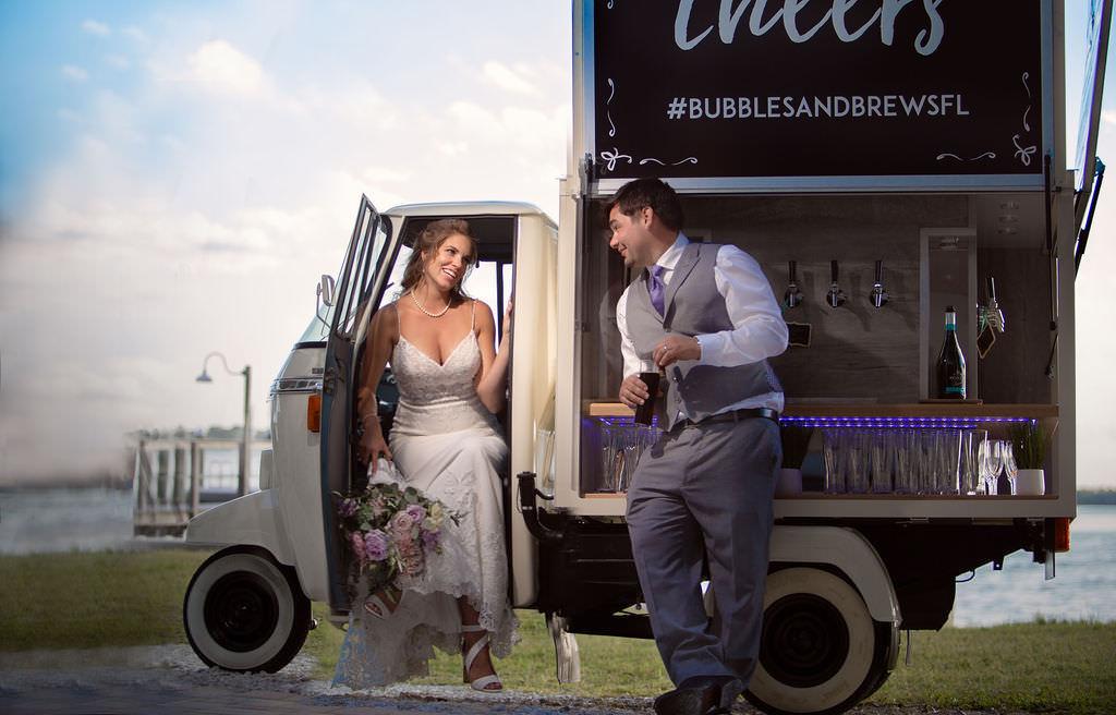 Spring Tampa Bay Bride and Groom Wedding Portrait with Unique Beverage Cart Get Cozy Bubbles & Brew