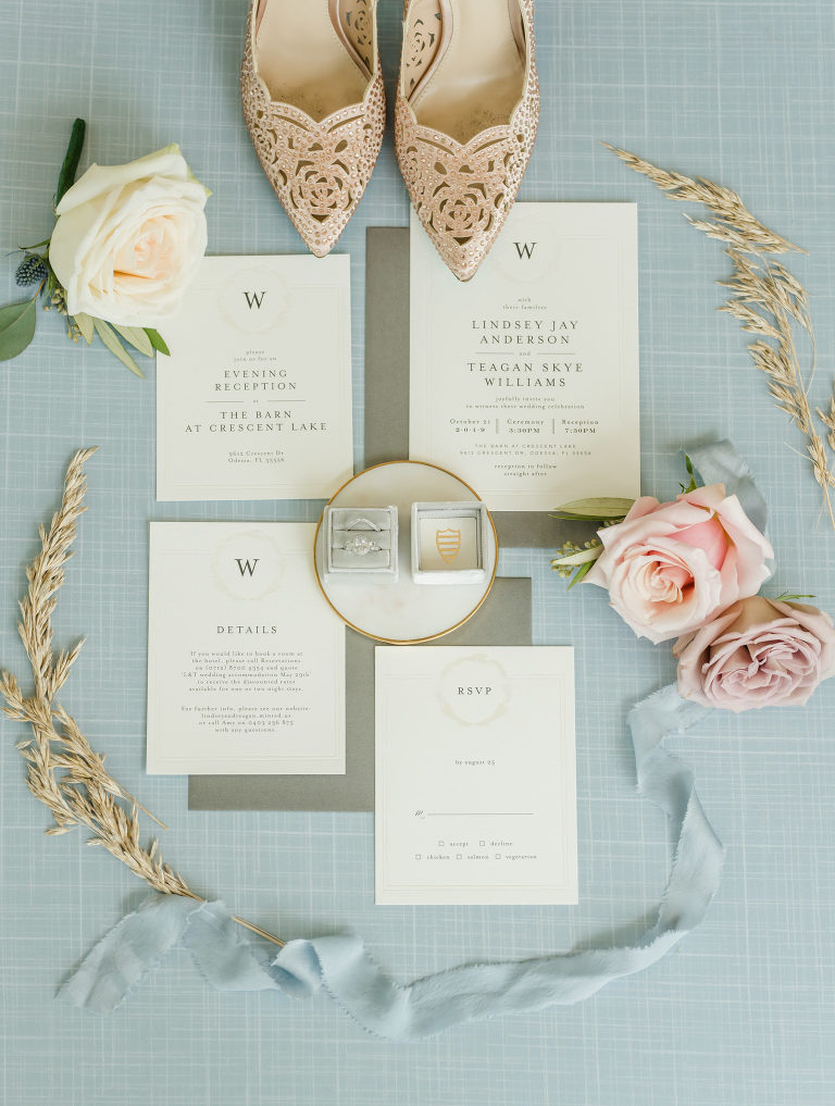 Elegant Bridal Details Shot, Wedding Invitation Suite with Monogram, Dusty Blue The Mrs. Ring Box with Diamond Engagement Ring and Wedding Band, Dusty Rise Gold Shoes | Tampa Bay Wedding Planner Elegant Affairs by Design