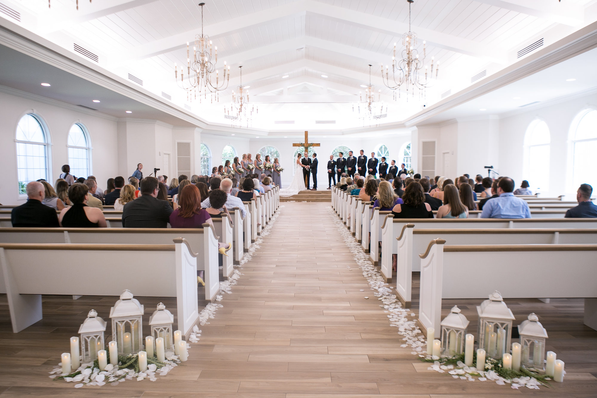 Traditional Church Wedding Ceremony Bride and Groom Exchanging Vows Portrait   Tampa Bay Wedding Photographer Carrie Wildes Photography   Safety Harbor Wedding Venue Harborside Chapel   Wedding Planner Love Lee Lane