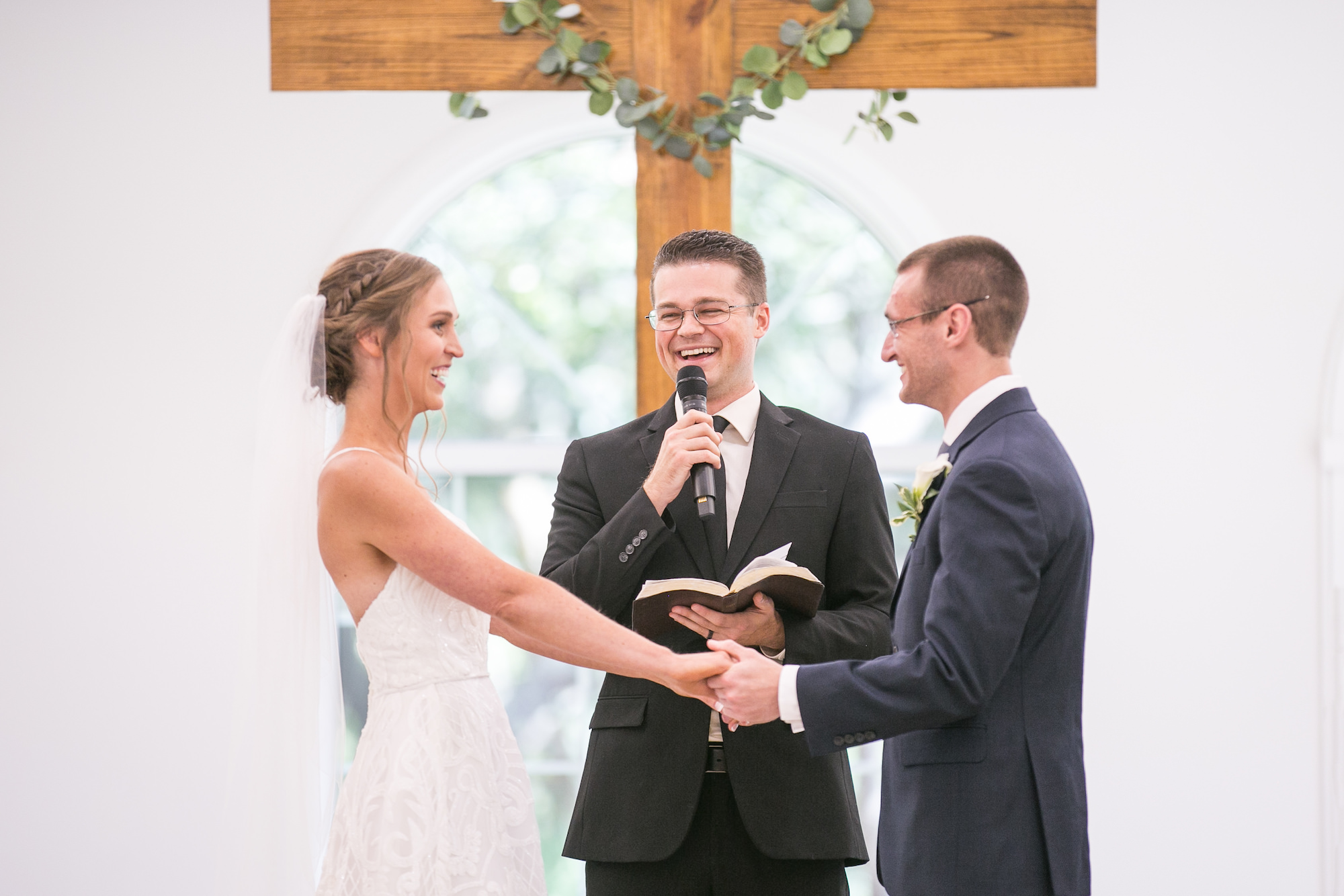 Classic Bride and Groom Exchanging Wedding Vows During Traditional Church Ceremony   Tampa Bay Wedding Photographer Carrie Wildes Photography   Safety Harbor Wedding Venue Harborside Chapel