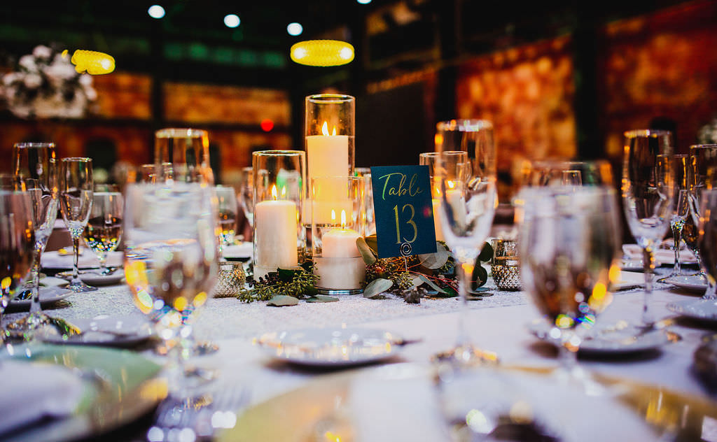 Classic Florida Wedding Decor at Reception, Low Centerpieces with Candlelight Votives, Navy and Gold Table Number | Tampa Wedding Planner Coastal Coordinating