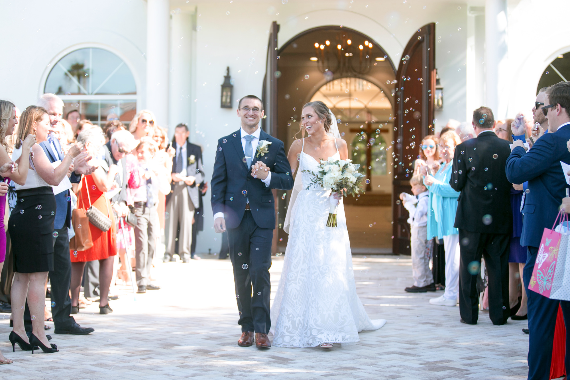 Classic Bride and Groom Wedding Ceremony Bubble Exit   Tampa Bay Wedding Photographer Carrie Wildes Photography   Safety Harbor Wedding Venue Harborside Chapel   Wedding Planner Love Lee Lane