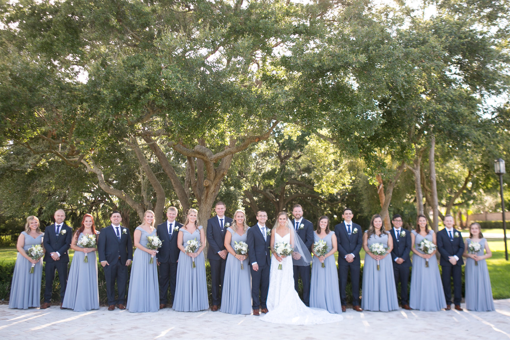 Bridesmaids in Dusty Blue Matching Dresses, Groomsmen in Blue Suits Wedding Party Portrait   Tampa Bay Wedding Photographer Carrie Wildes Photography   Wedding Planner Love Lee Lane