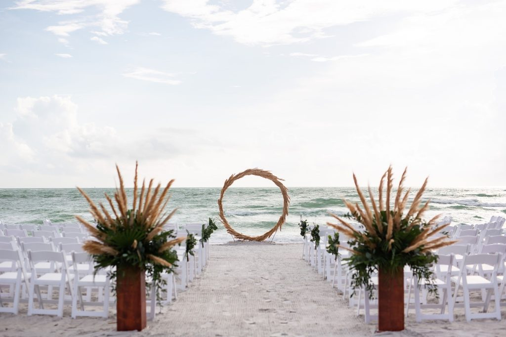 Tropical Boho Outdoor Florida Beach Wedding Ceremony with Straw Circular Geometric Ceremony Arch | Sarasota Wedding Venue Longboat Key Club