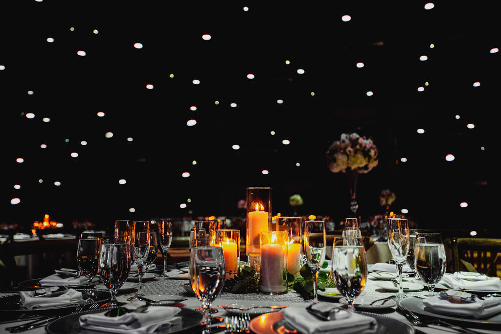 Romantic Starry Sky Florida Wedding Decor at Reception, Low Centerpieces with Candlelight Votives, Navy and Gold Table Number | Tampa Wedding Planner Coastal Coordinating