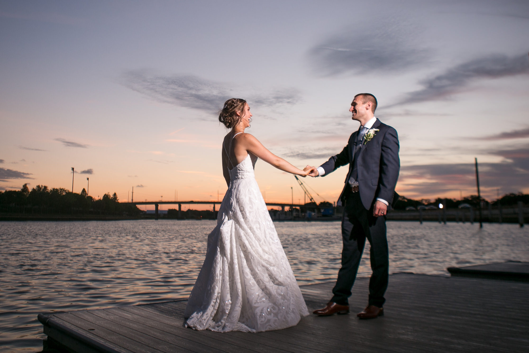 Sunset Bride and Groom Waterfront Wedding Portrait   Tampa Bay Wedding Photographer Carrie Wildes Photography
