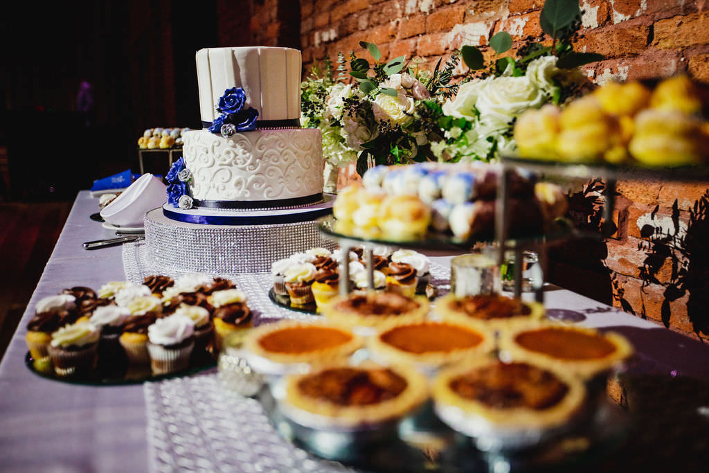 Florida Wedding Dessert and Cake Table, Classic Two Tier Buttercream Frosted Wedding Cake with White Iced Piping, Navy Ribbon, and Silver Accents, Italian Treats and Desserts | South Tampa Bakery Alessi Bakeries