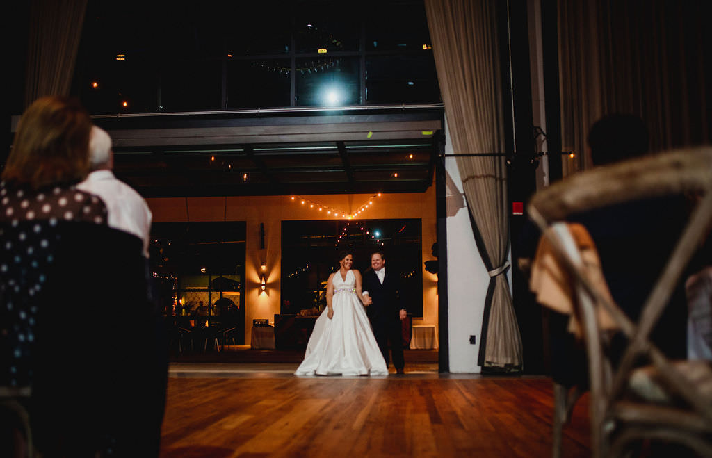 Florida Bride and Groom First Dance in The Gathering at Armature Works in Tampa Heights | Tampa Bay Entertainers Bay Kings Band | Tampa Wedding Planner Coastal Coordinating