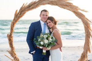 Tropical Outdoor Florida Beach Wedding Ceremony with Straw Circular Geometric Ceremony Arch | Sarasota Wedding Venue Longboat Key Club