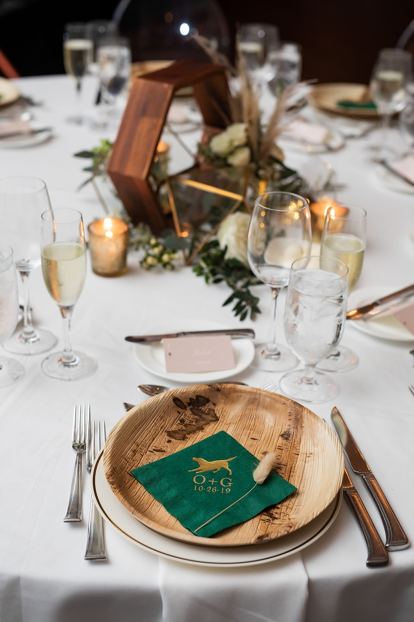 Boho Florida Wedding Reception Decor With Wooden And Greenery Centerpieces With Bamboo Plates And Personalized Dog Monogram Napkins Marry Me Tampa Bay Local Real Wedding Inspiration Vendor Recommendation Reviews