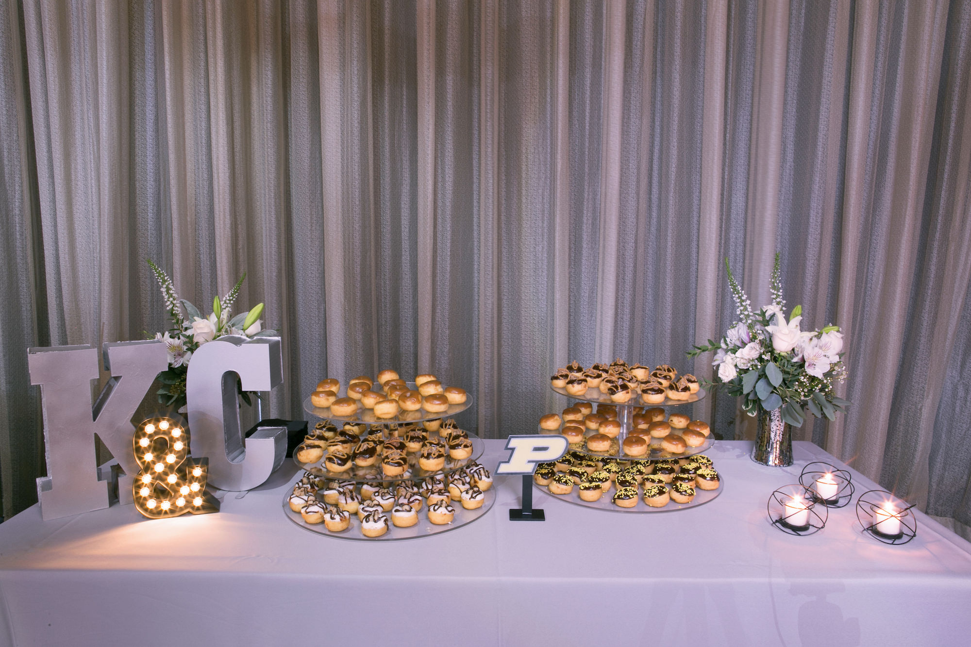 Three Tier Dishes of Cream Puffs Dessert Table on Silver Linen with Large Metal K & C Letters   Tampa Bay Wedding Photographer Carrie Wildes Photography   Wedding Planner Love Lee Lane