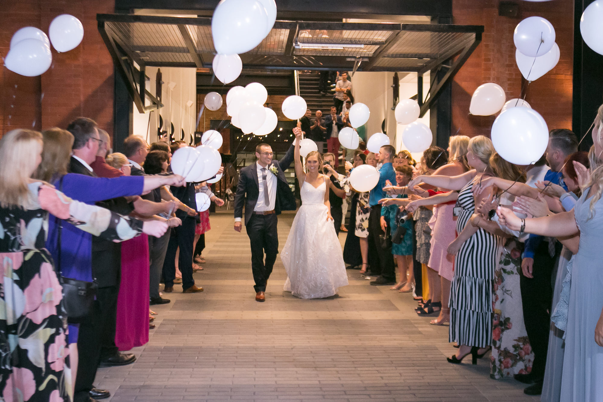 Fun Bride and Groom Wedding Reception Send-Off with Balloons   Tampa Bay Wedding Photographer Carrie Wildes Photography   Industrial Historic Wedding Venue Armature Works   Wedding Planner Love Lee Lane