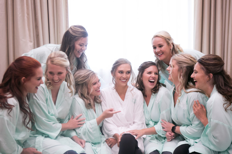 Fun Bride and Bridesmaids in Mint Robes Getting Wedding Ready Portrait | Tampa Bay Wedding Photographer Carrie Wildes Photography