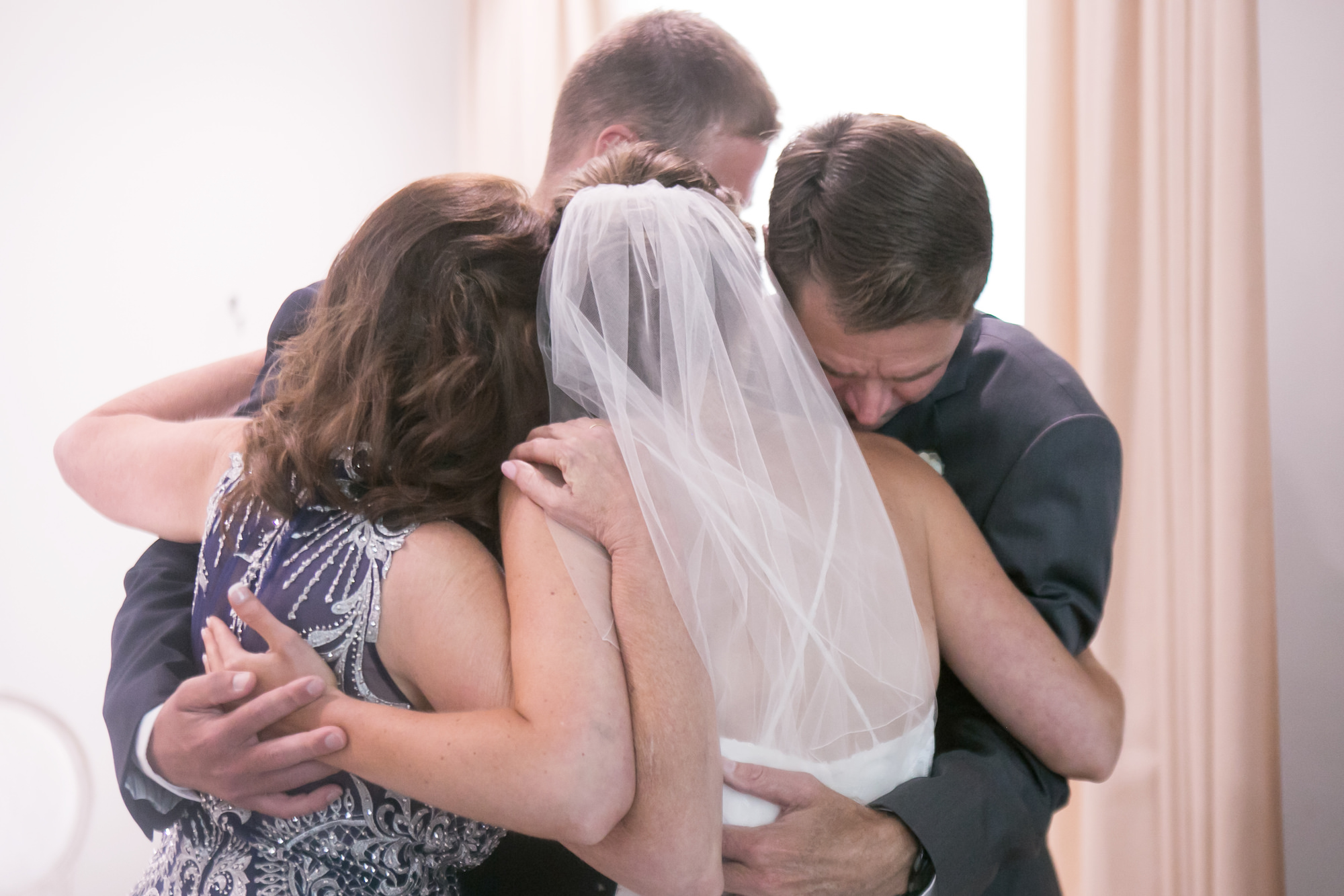 Bride with Family Prayer Circle Wedding Portrait   Tampa Bay Wedding Photographer Carrie Wildes Photography
