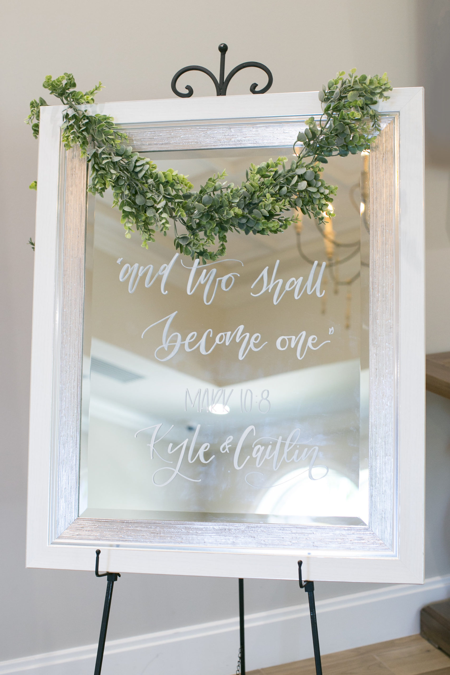 Classic Elegant White Framed Mirror with Script Font Welcome Sign with Greenery Garland   Tampa Bay Wedding Photographer Carrie Wildes Photography   Wedding Planner Love Lee Lane