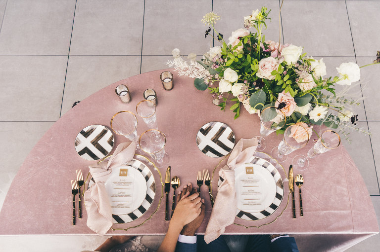 Modern Art Deco Whimsical Inspired Reception Sweetheart Table with Crushed Velvet Linen and Black and White Plates with Gold Glass Charger Plate and Gold Flatware | Tampa Wedding Florist Monarch Events and Designs | Tampa Wedding Rentals Kate Ryan Event Rentals