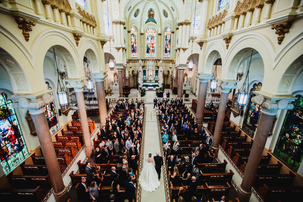 Classic Florida Bride Walking Down the Aisle During Downtown Tampa Wedding Ceremony At Sacred Heart Catholic Church | Florida Luxury Wedding Planner Coastal Coordinating