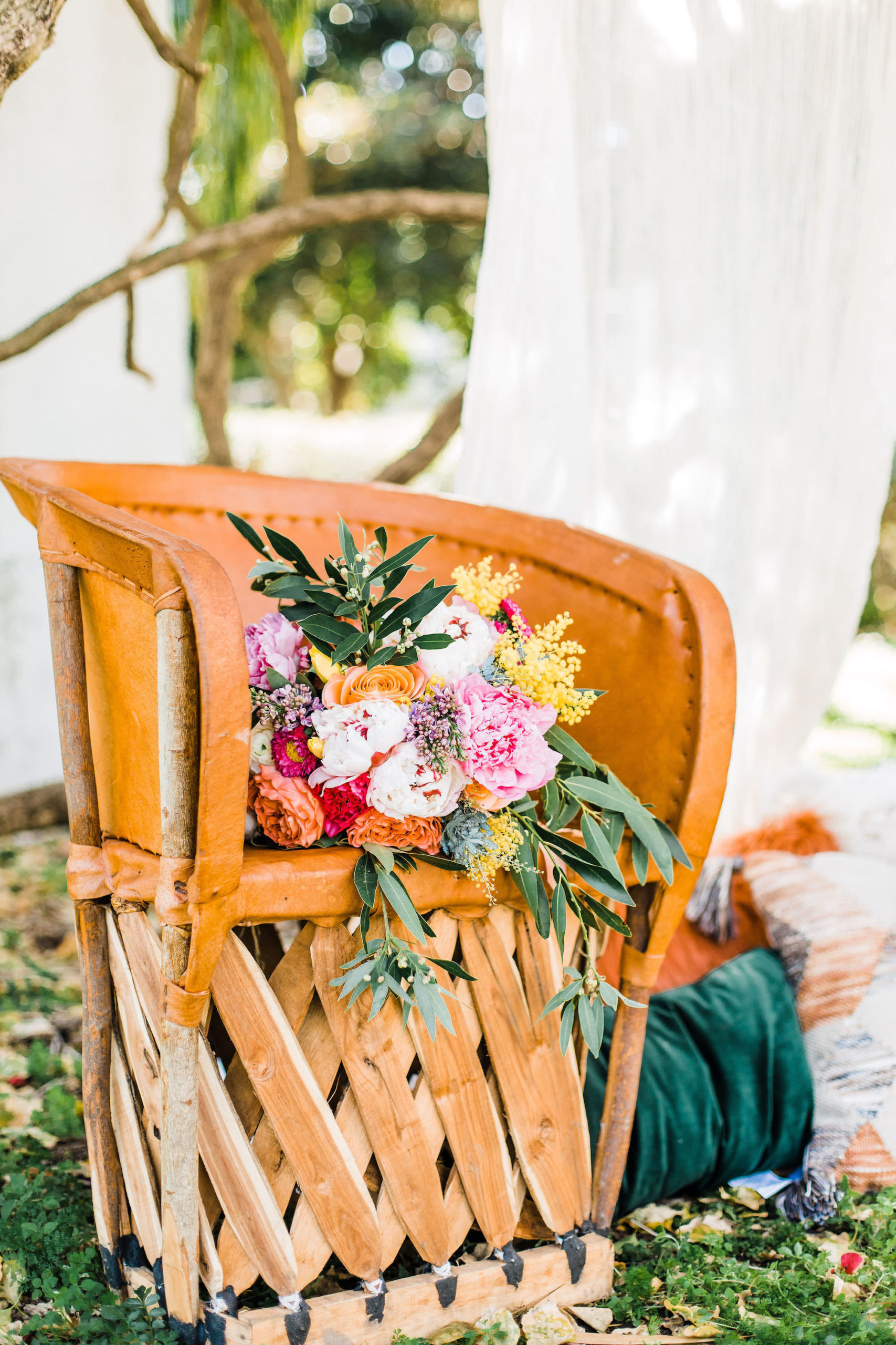 Boho Inspired Watercolor Outdoor Bridal Wooden Chair with Whimsical Colorful Bouquet
