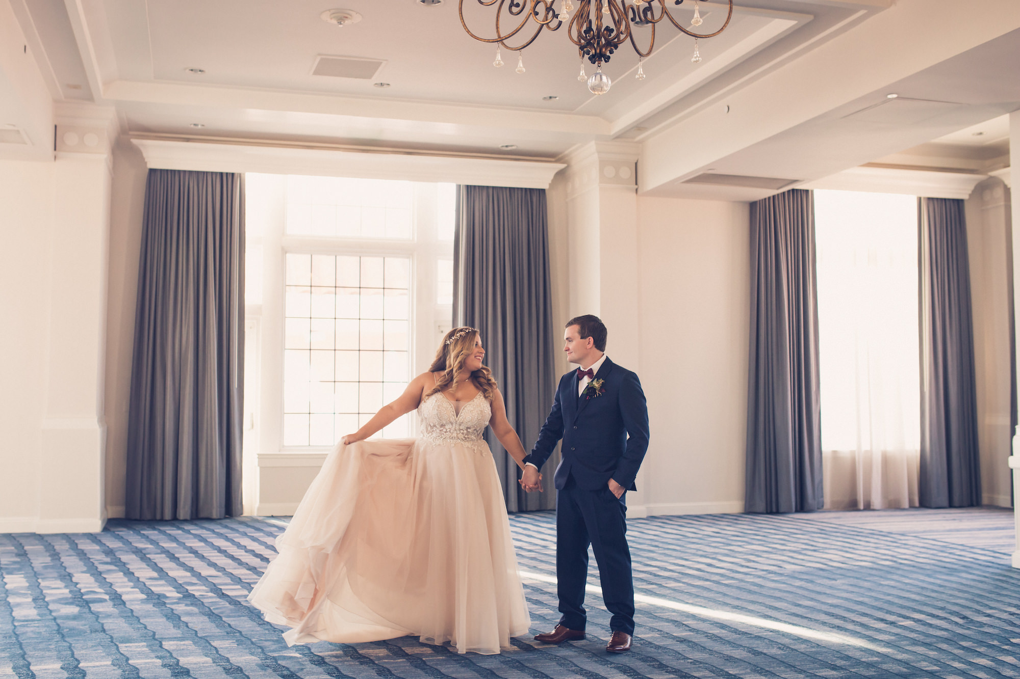Tampa Bride and Groom Wedding Portrait in The Pink Palace Historic St. Pete Wedding Venue The Don CeSar | Wedding Photographer Luxe Light Images