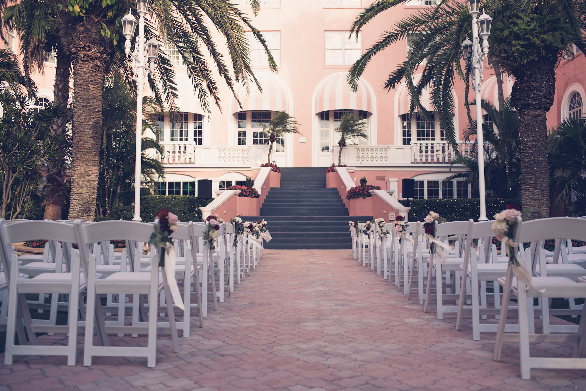 Outdoor Hotel Courtyard Wedding Ceremony Portrait | Historic Waterfront Hotel St. Pete Beach Wedding Venue The Don CeSar | Wedding Photographer Luxe Light Images