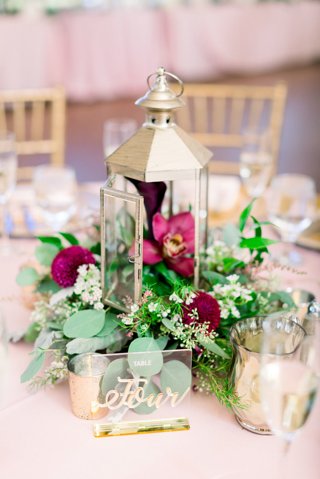 Rustic Elegant Wedding Ballroom Reception Venue, Small Brushed Gold Lantern with Organic Eucalyptus, Greenery and Maroon Floral Arrangement, Clear Acrylic with Gold Calligraphy Table Number Sign | Tampa Bay Wedding Photographer Shauna and Jordon Photography