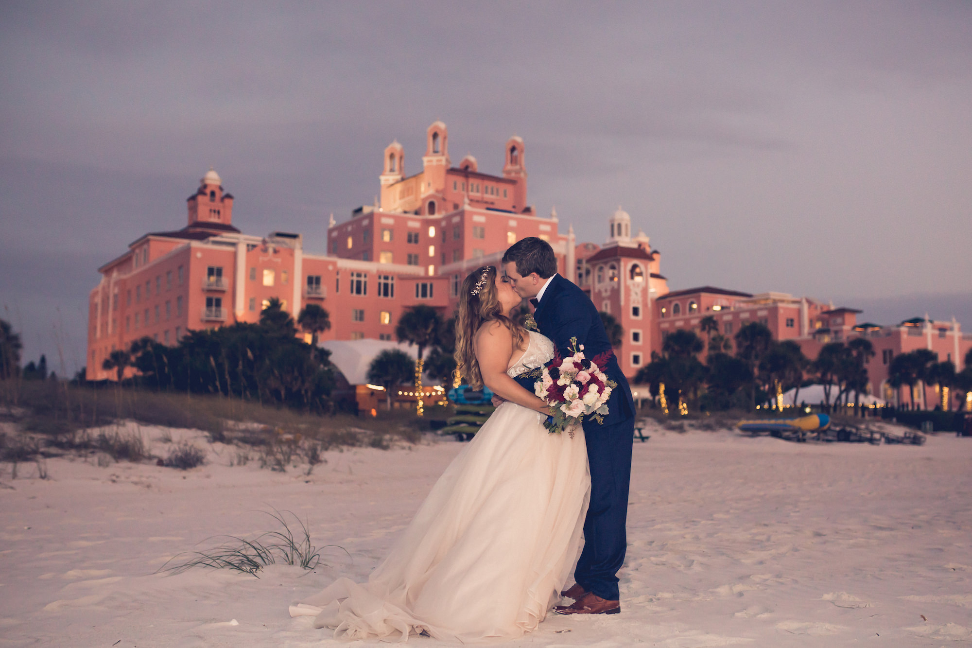 Romantic Sunset Beach Bride and Groom Wedding Portrait at Historic St. Pete Pink Palace Hotel Wedding Venue The Don CeSar | Wedding Photographer Luxe Light Images