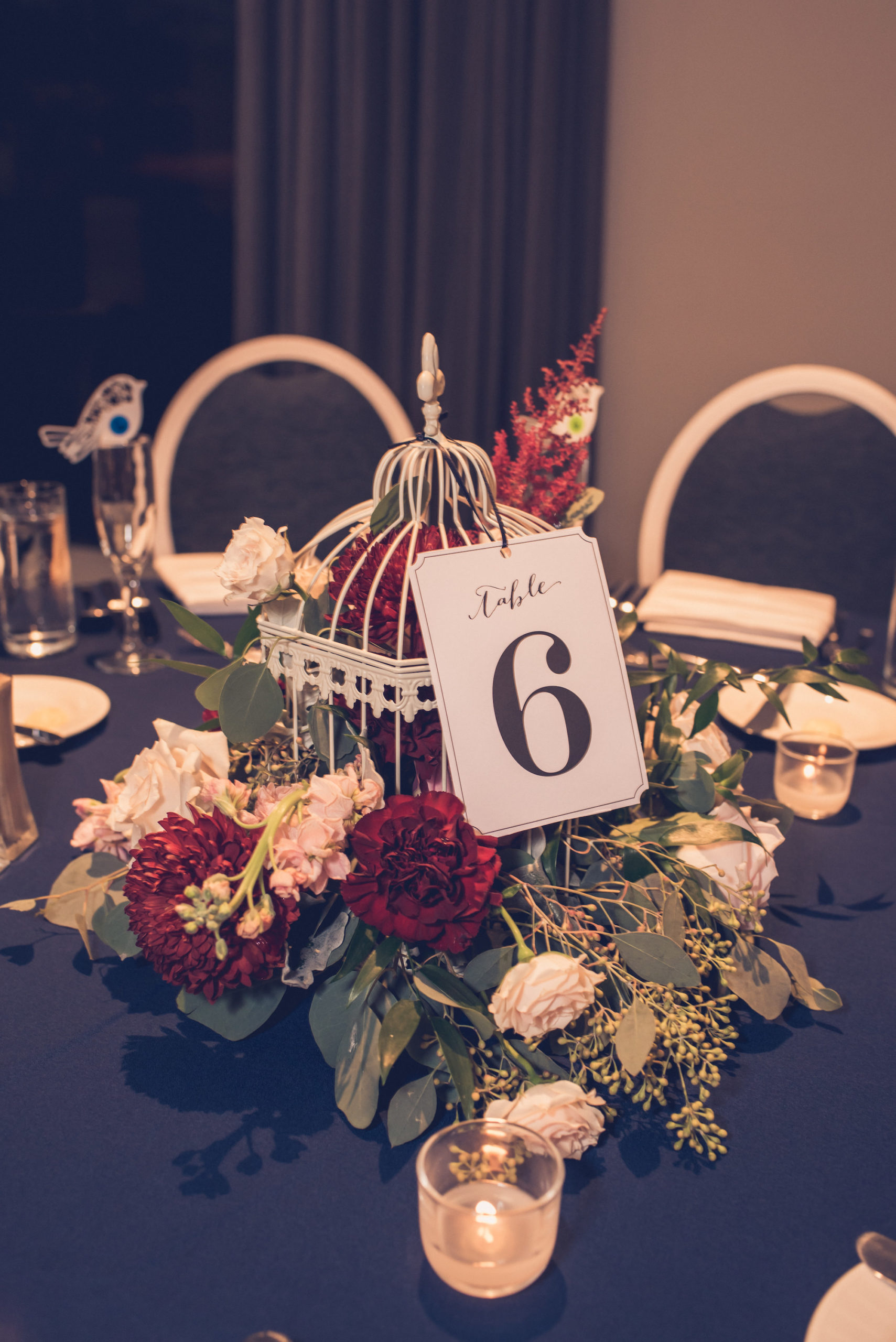 Quirky Elegant Wedding Reception Decor, White Birdcage with Burgundy Flowers, Blush Pink Roses, Eucalyptus Leaves Floral Centerpiece | Wedding Photographer Luxe Light Images