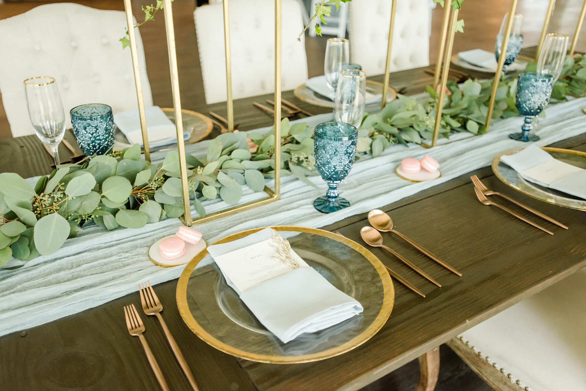 Dusty Rose Styled Wedding Shoot, Clear Glass and Gold Rimmed Chargers, White Linens with Custom Stationary, Eucalyptus Greenery Garland and White Fabric Table Runner, Blue Wine Glasses, Rose Gold Flatware, Pink Macaroons   Tampa Bay Wedding Planner Elegant Affairs by Design