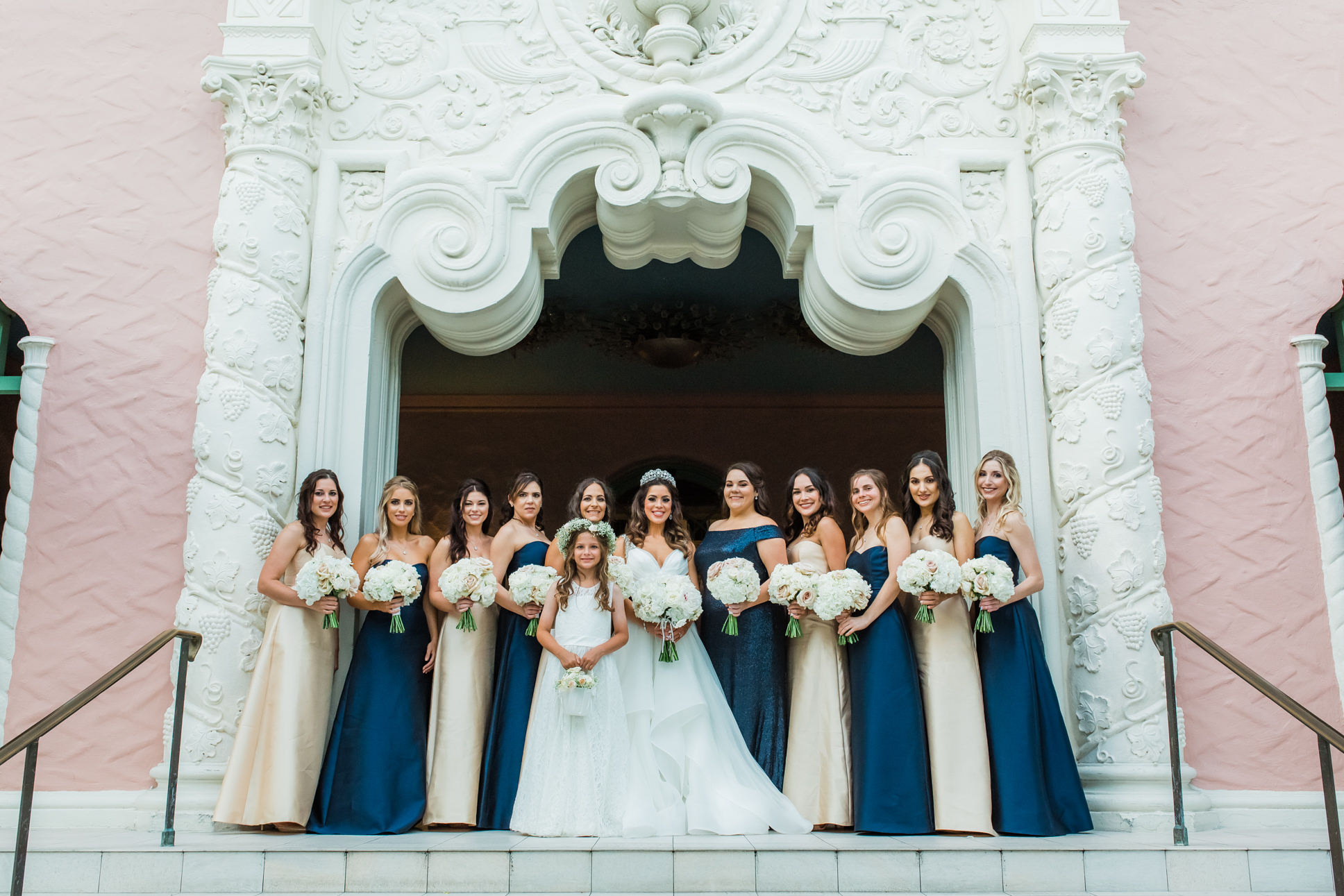 St. Pete Bride in Hayley Paige Wedding Dress, Bridesmaids in Mix and Match Navy Blue and Gold Dresses, Flower Girl in White Dress Bridal Party Portrait