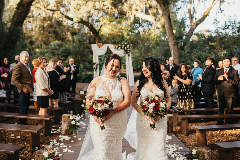 Rustic Country Fall Winter Outdoor Wedding Decor Draped Wood Ceremony Arch White Red and Greenery | Same Sex Wedding Brides LGBTQ | Florida Same Sex Wedding